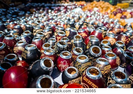 BUENOS AIRES - DECEMBER 17, 2017. Calabash gourds lay on the ground on the street during sunday market in San Telmo district of the city of Buenos Aires, Argentina