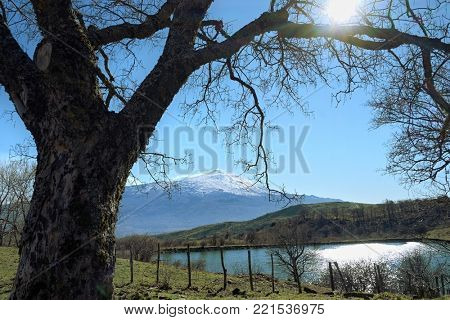 sicilian landscape with pond and Etna Mount snow covered from Nebrodi Park, Sicily