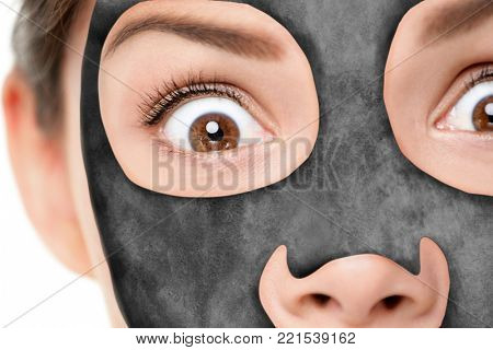 Funny beauty facial treatment woman putting charcoal mask looking shocked. Scared or surprised girl with luxury skincare mask on face, shocked of chemical product. Dangers of skin care products.