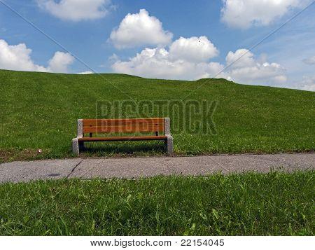 public seat on grass