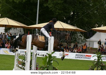 Girl jumping Pony on horseshow