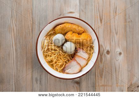 Top view Curry Laksa, which is a popular traditional spicy noodle soup from the culture in Malaysia.