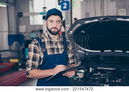 Bearded Specialist, Technician Expert In Protective Glasses, Blue Overall, Checkered Shirt Is Analyz