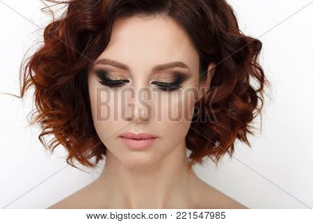 Close Up Beauty Studio Shot Of Beautiful Redhead Woman With Gorgeous Makeup Curly Hair Holding Color