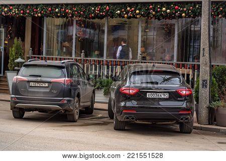 ROSTOV-ON-DON, RUSSIA - CIRCA DECEMBER 2017: Maserati Levante parked outside restaurant, back view.