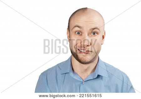 White man in a blue shirt on a white background. Split personality.