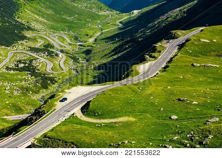 Transfagarasan mountain road in the valley, view from above. beautiful transportation scenery in summertime