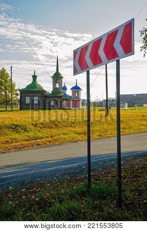 Nizhnaya Sinyachikha, Russia - September 24, 2013: Road sign to Efsima's and Savvatiya Solovetskikh chapel, chapel of Saviour of Transformation