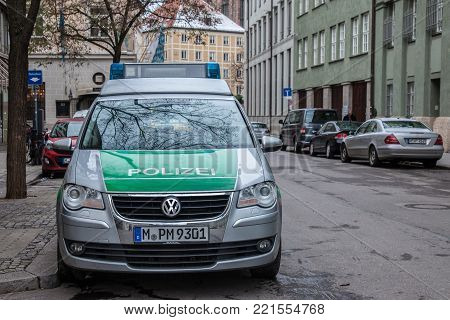 MUNICH, GERMANY - DECEMBER 18, 2017: Volkswagen from the Bavarian State police (polizei) taken in Munich. The Bavarian State Police is in charge of law enforcement in the State of Bavaria.