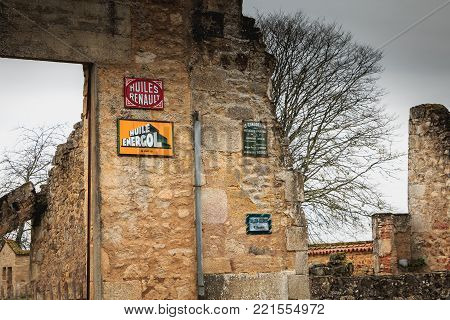 ORADOUR SUR GLANE, FRANCE - December 03, 2017 : remains in ruins destroyed by the fire of the RENAULT garage after the massacre of the population by the Nazis on June 10, 1944