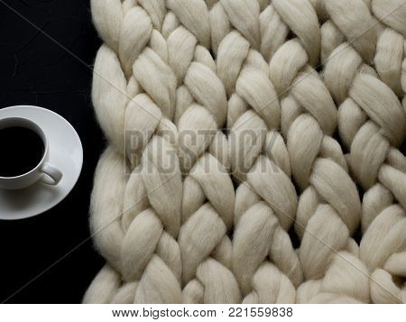 Cozy composition, closeup merino wool blanket, warm and comfortable atmosphere. Knit background