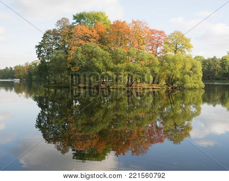 Autumn landscape. Reflection of autumn forest on the surface of the lake. Catherine park, Tsarskoe Selo, St.Petersburg, Russia. Golden autumn in Pushkin.