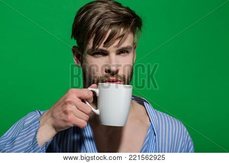 Guy With Tea Or Coffee Cup, Magazine In Dressing Gown
