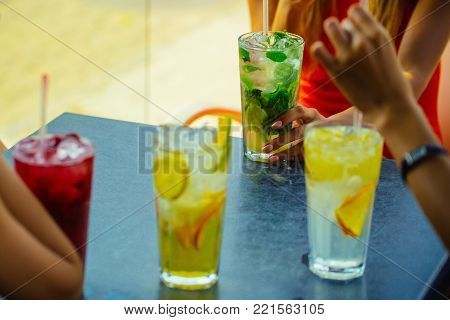 Party and summer vacation. Cocktails mix with fruit for girls party in bar. Thirst and refresh. women drink cocktail with ice cube. Bar and restaurant, cocktail party. poster