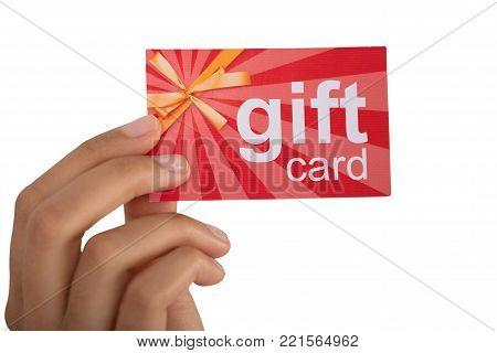 Close-up Of Person's Hand Holding Gift Card Against White Background