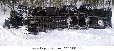 Overturned truck on the snow on winter day