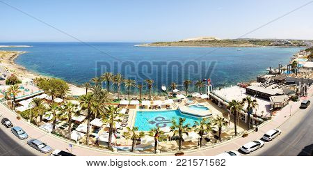 BUGIBBA, MALTA - APRIL 23: The tourists are on vacation at popular hotel on April 23, 2015 in Bugibba, Malta. More then 1,6 mln tourists is expected to visit Malta in year 2015.