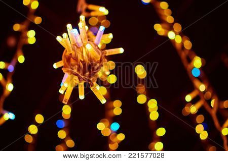 Soft focus christmas garland with have bokeh light glittering bright background, For use decoration festival and happy new year background. Soft blurred and de-focused.