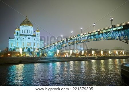 Night winter view to the Cathedral of Christ the Saviour with bridge and river