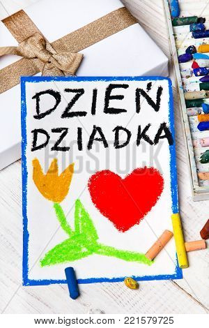 Polish Grandfather's Day card with words: Grandfather's Day. Colorful hand drawing, crayons and gift box.