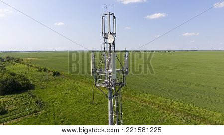 Cellular tower. Equipment for relaying cellular and mobile signal. Fly around up and down.