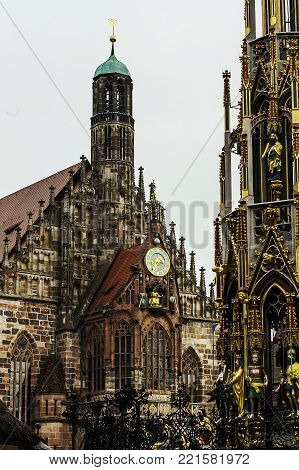 Facade of Frauenkirche Church of Our Lady is a catholic church and Schoner Brunnen fountain in Hauptmarkt market in Nuremberg, Germany. Gothic architecture in Bavaria.