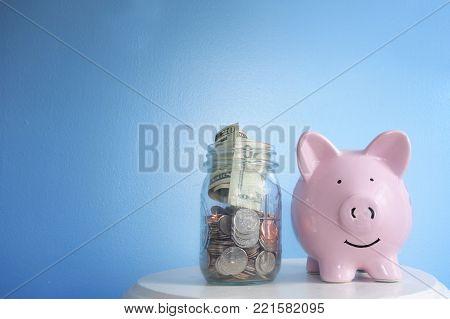 Happy piggy bank and jar of money