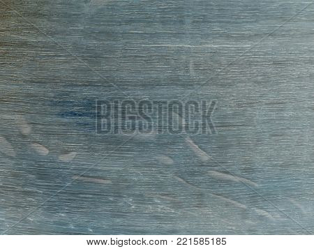 The old table top, worn out stained  navy blue with shades. Fine structure of cherry wood saturated with blue mordant