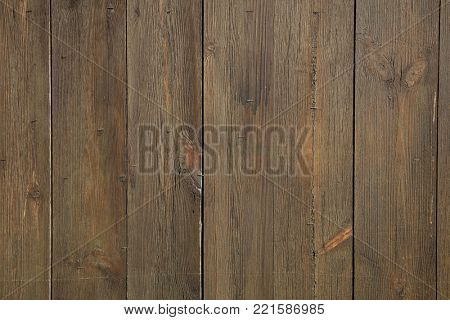 Dark brown, wooden, blank, vintage backdrop. Space for text, abstract, close up view with details.