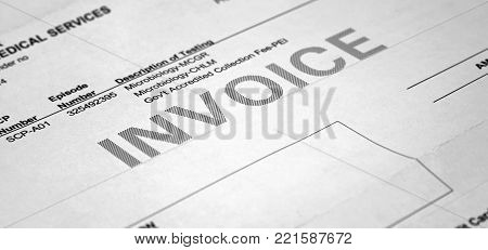 Medical insurance bill closeup and the invoice