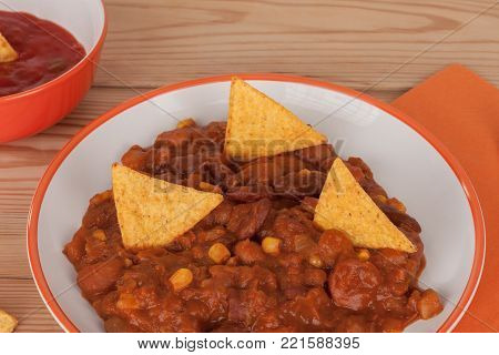 Chili Con Carne With Salsa Sauce And Tortilla Chips