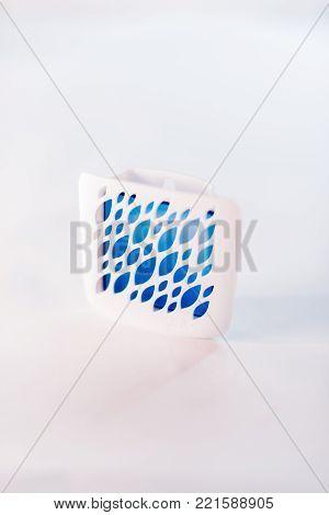 Air freshener on a white blurred background