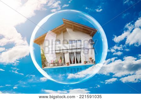 Close-up Of House Inside Bubble Against Cloudy Sky