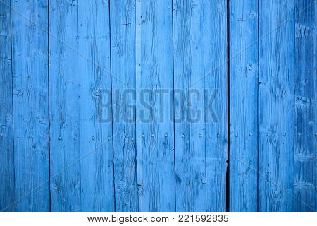 Bright blue wooden, blank, vintage backdrop. Space for text, abstract, close up view with details.