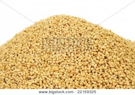a pile of soy lecithin granules on a white background