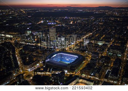 Panoramic aerial view of Puerta de Alcala day to night, main shopping street in Madrid Skyline Old Town Cityscape, Metropolis Building lights turn on, capital of Spain, Europe