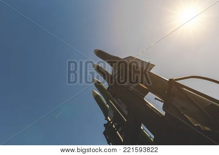 Rockets of an anti-aircraft missile system are directed to the blue sky