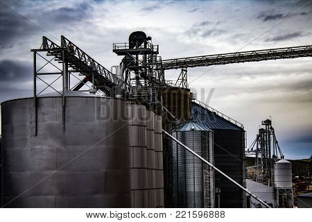 Grain Elevators at the Railroad Tracks on an Overcast Day poster