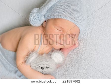 Portrait of infant baby boy sleeping