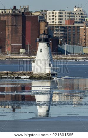 Palmer's Island lighthouse reflecting in icy Acushnet River, New Bedford, Massachusetts