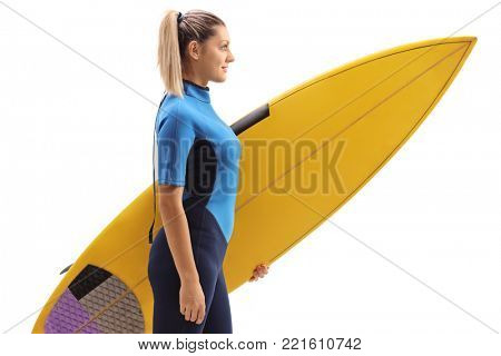 Profile shot of a female surfer with a surfboard isolated on white background