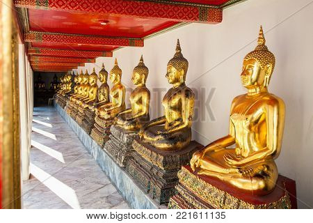 Bangkok, Thailand - Jan 21 2016:Row of golden buddha statues at Wat Pho known also as the Temple of the Reclining Buddha in  Bangkok on Jan. 21. 2016. Thailand,