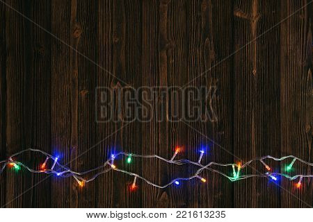 Fancy Blinker Light Bulbs Or Garlands And Wreath On Wood Table For Christmas Or New Years Decoration