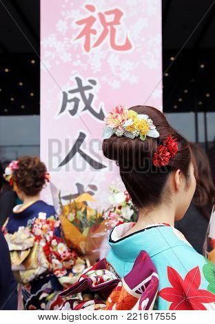KAGAWA, JAPAN - JANUARY 7, 2018: Young Japanese woman wearing traditional kimono for the coming of age day celebration, they turn twenty in Kagawa, Japan.
