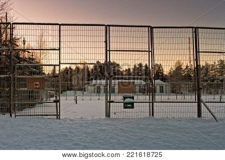 The public tennis court at a rural town of Oulainen, Finland has been covered with snow. The gate is still open and welcoming players at any time.