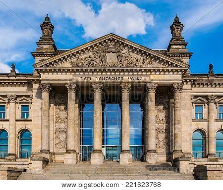Reichstag houses of parliament in Berlin, Germany - Dem Deutschen Volke means To The German People
