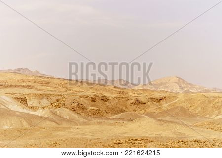 Beautiful nature desert in dry judean picturesque wilderness. Outdoor scenic landscape of mountains, sand and rocks near the dead sea. Travel in middle east in holy land in Israel