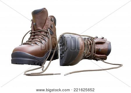 A pair of brand new hiking boots isoltaed on white.Concept prepared, ready, enduring, endurance, ready for anything.