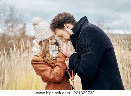Couple In Love Walking In The Autumn Park, Cool Fall Weather. A Man And A Woman Embrace And Kiss, Lo