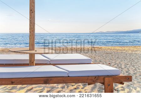Two Empty Sun Bed At Big Sandy Beautiful Beach For Relaxation
